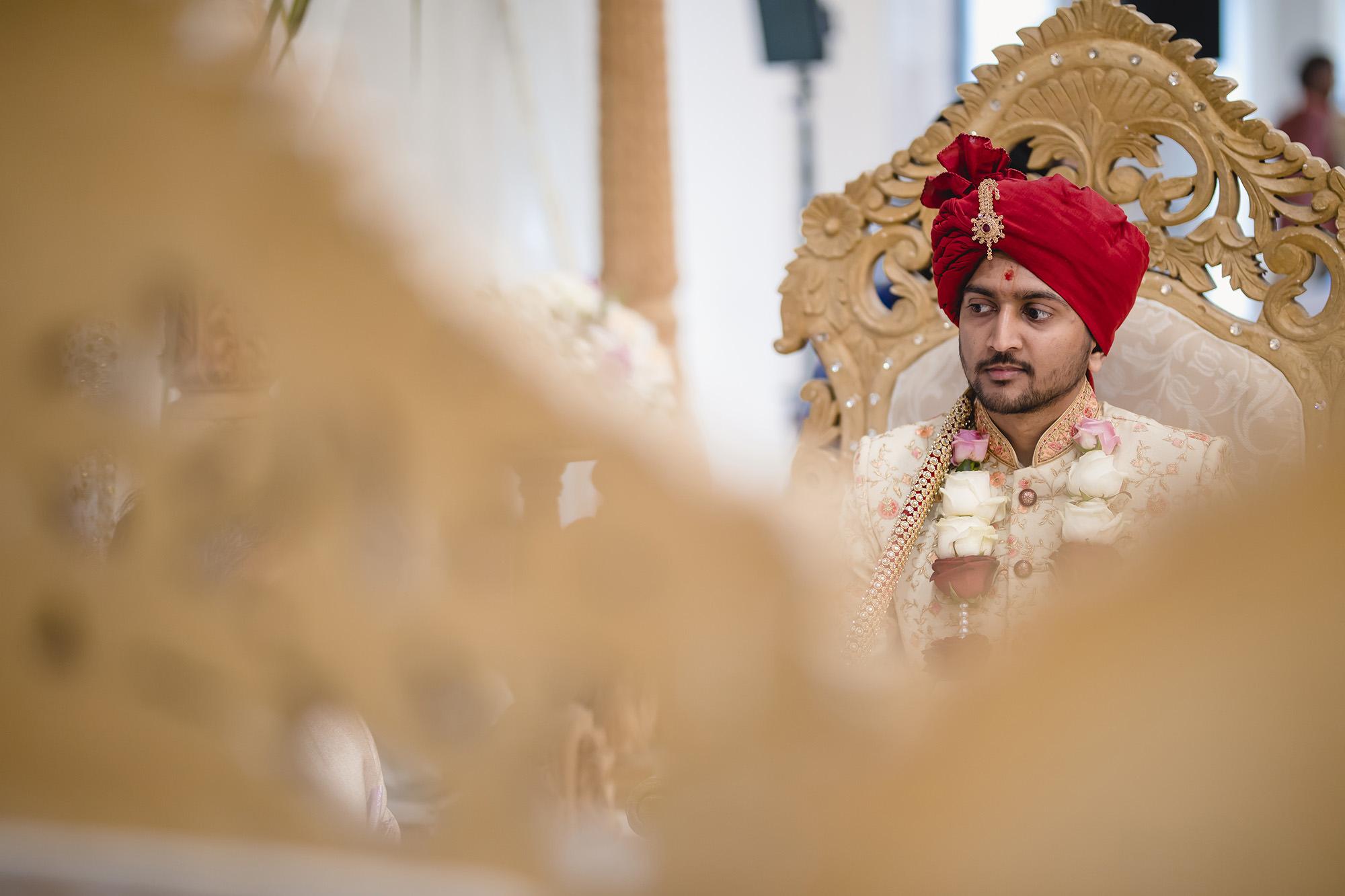 groom waiting in hindu mandap