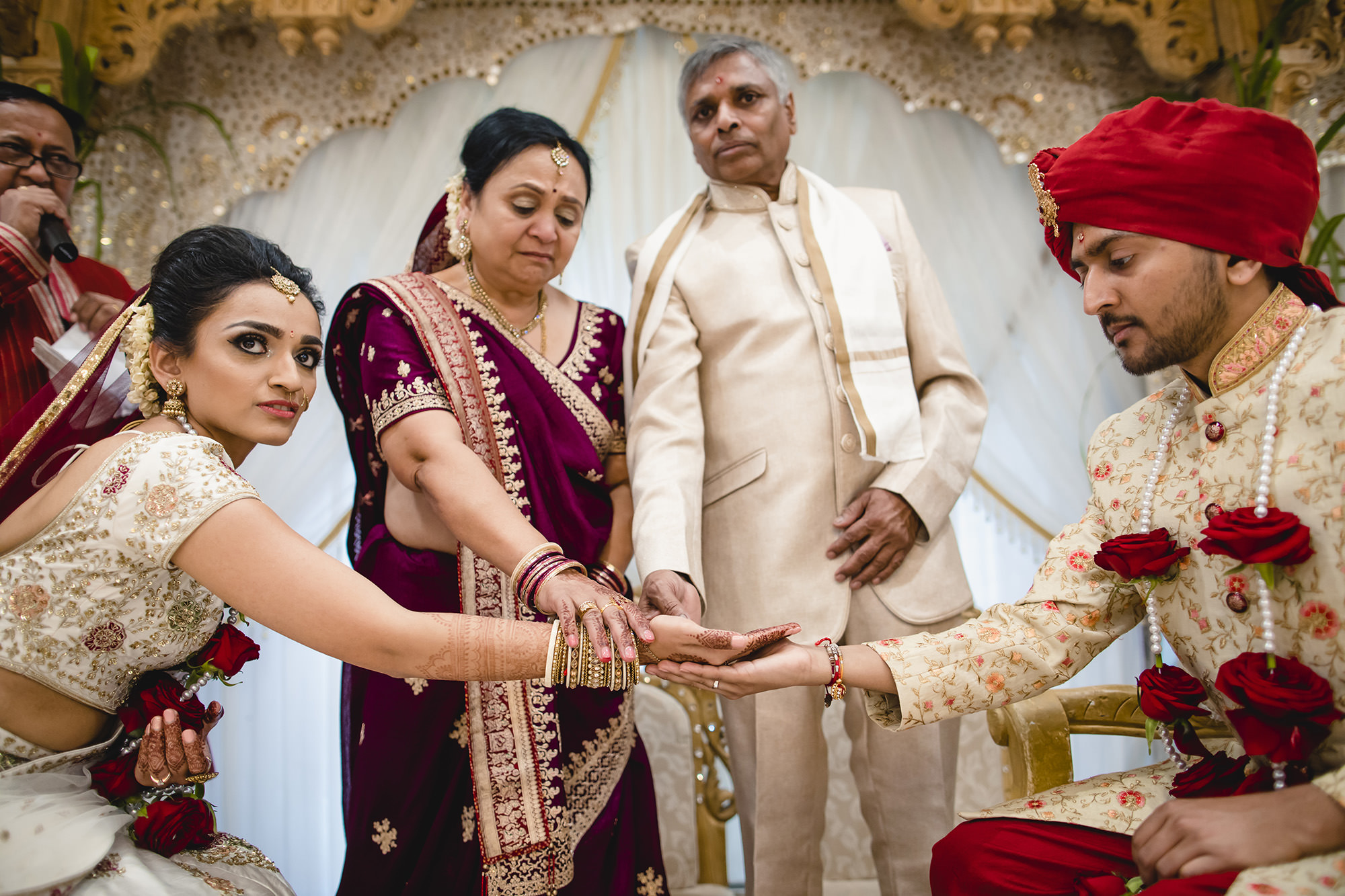 hindu wedding parents blessing bride and groom