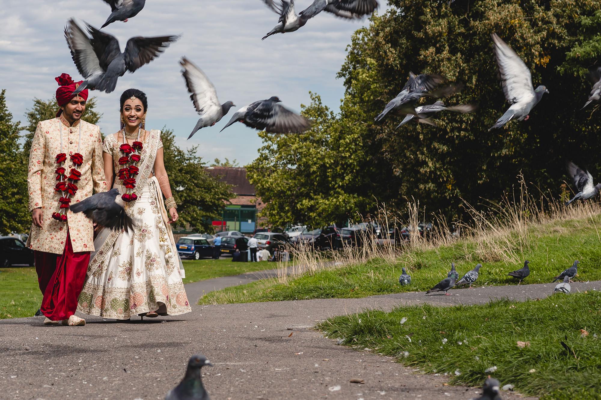 hindu bride and groom walking portrait