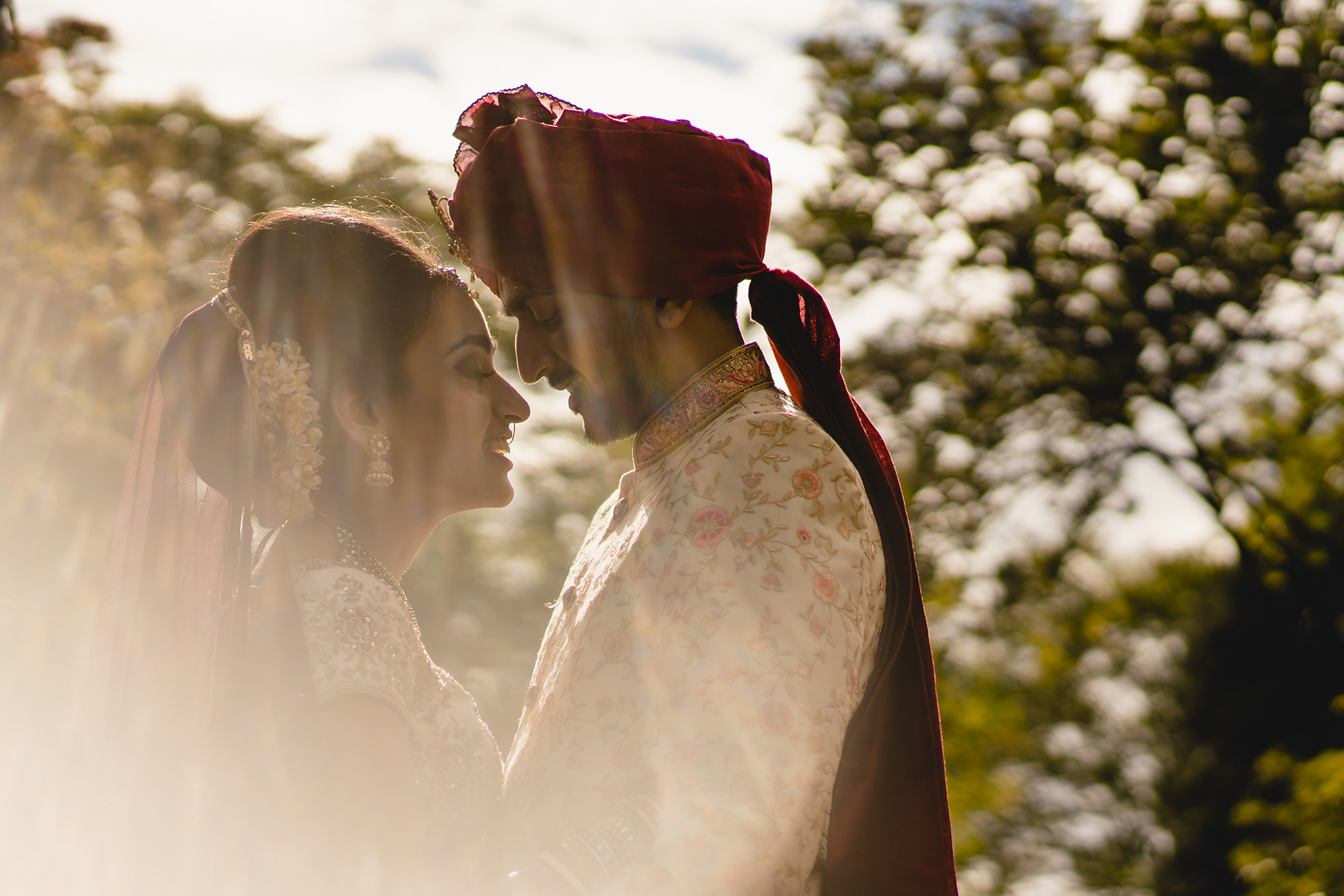 hindu bride and groom portrait with flare
