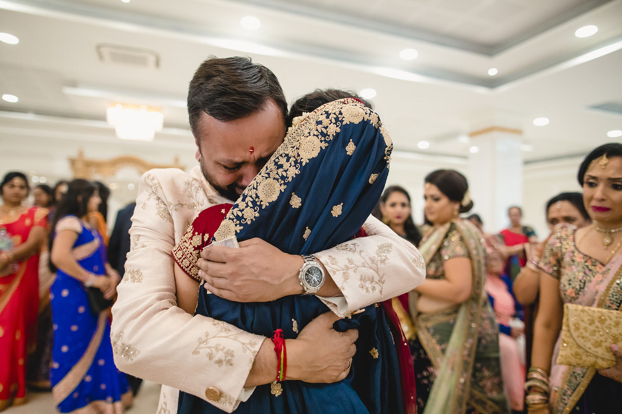 emotional hindu bride with family