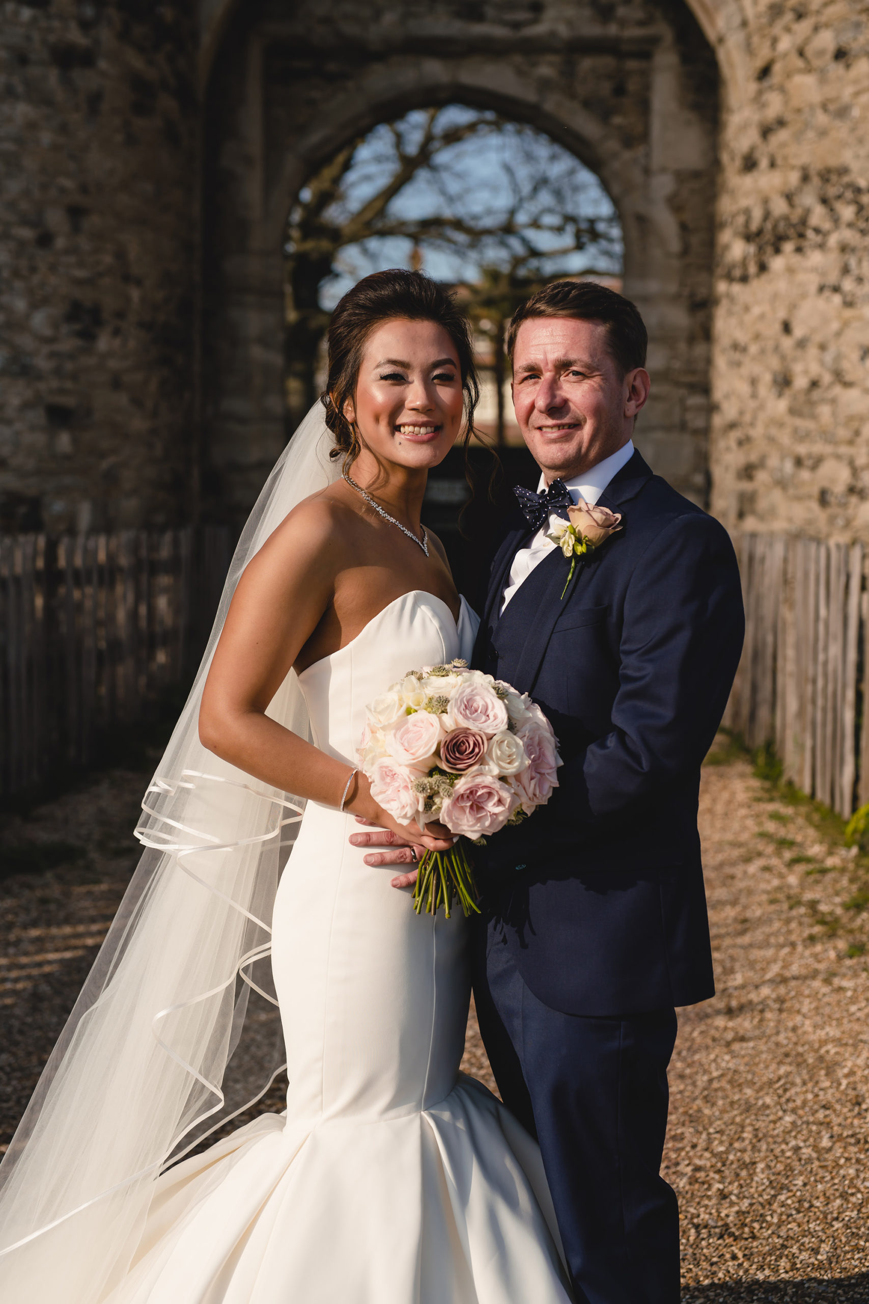 portrait of bride and groom cooling castle barn