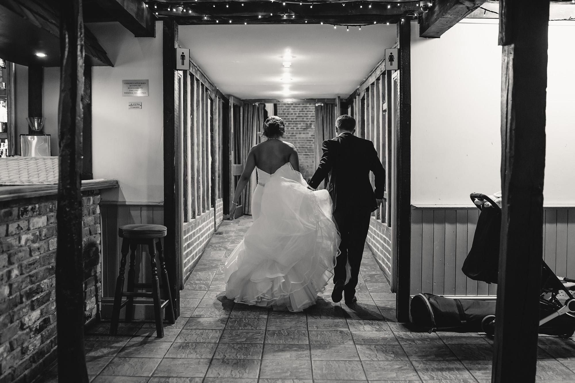 bride and groom exiting wedding breakfast