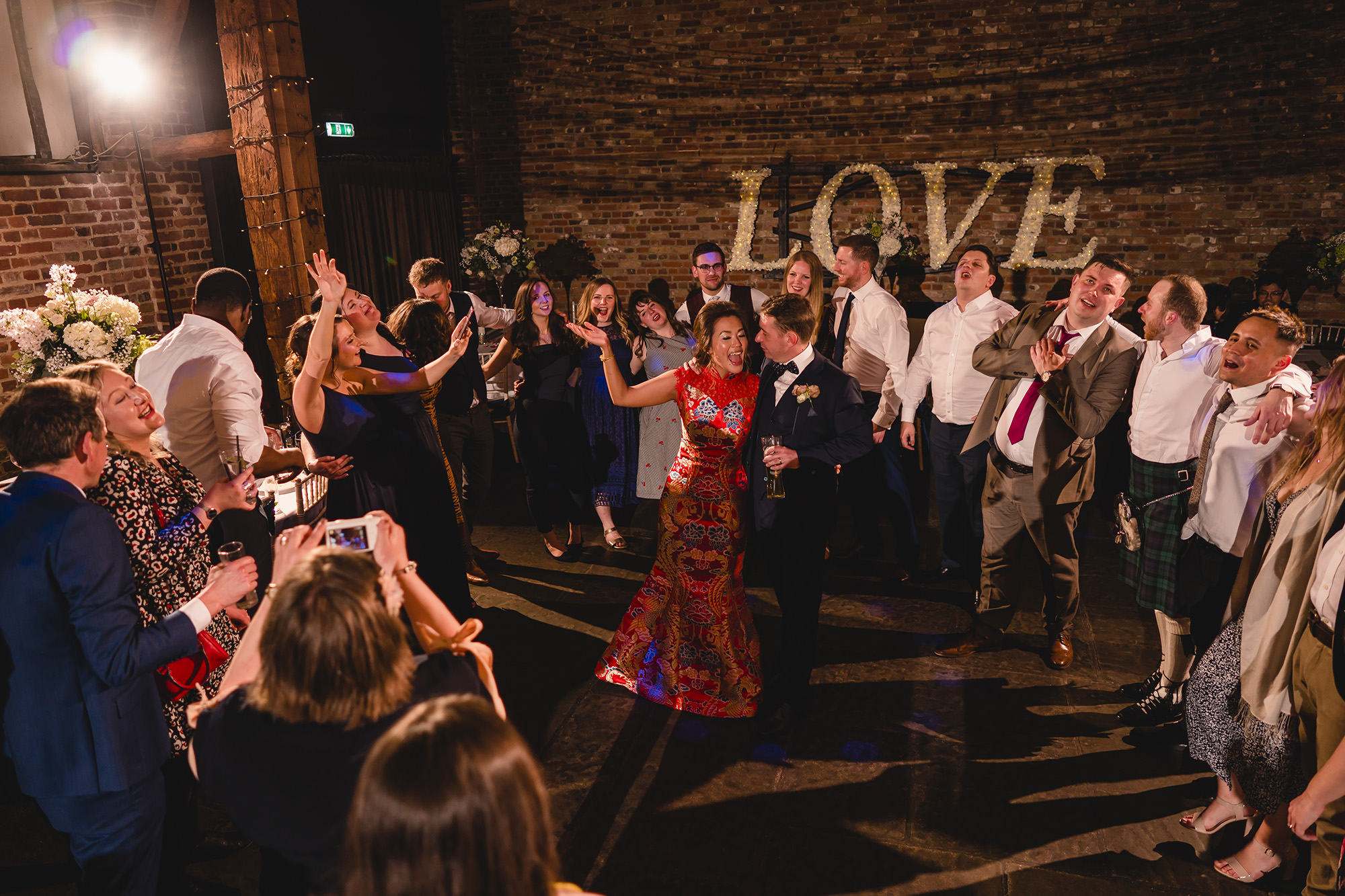 Bride and Groom dancing with reception guests