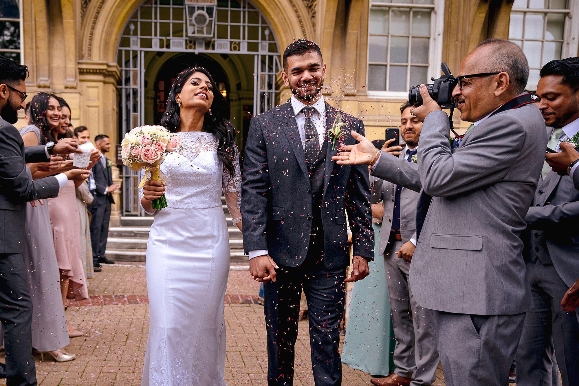 bride and groom exit confetti devan jigna