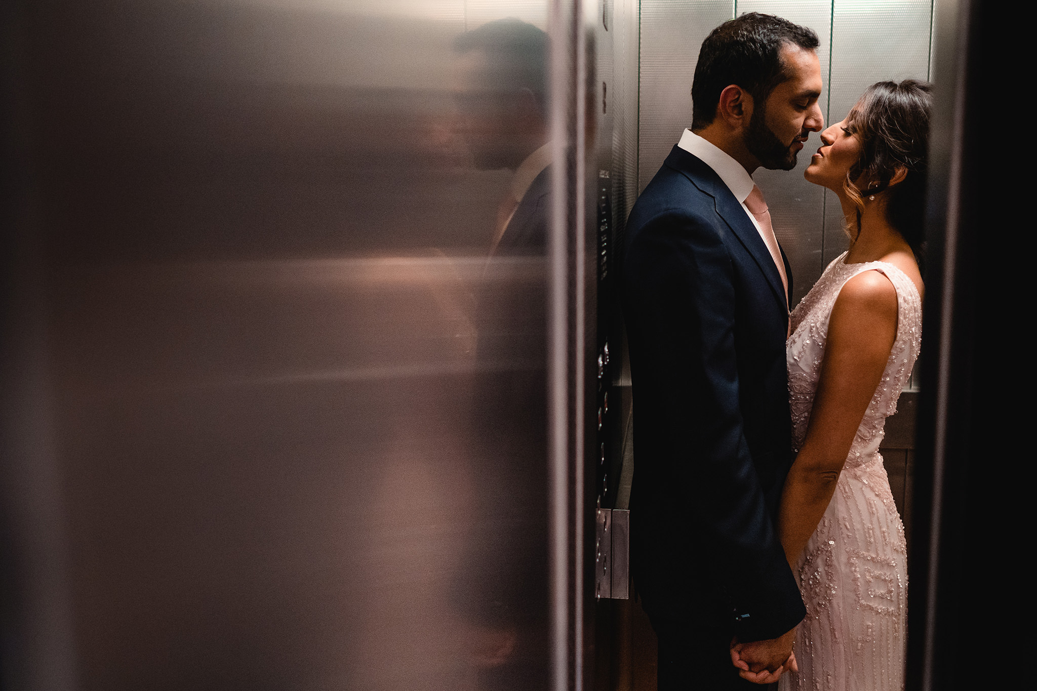 bride and groom in elevator