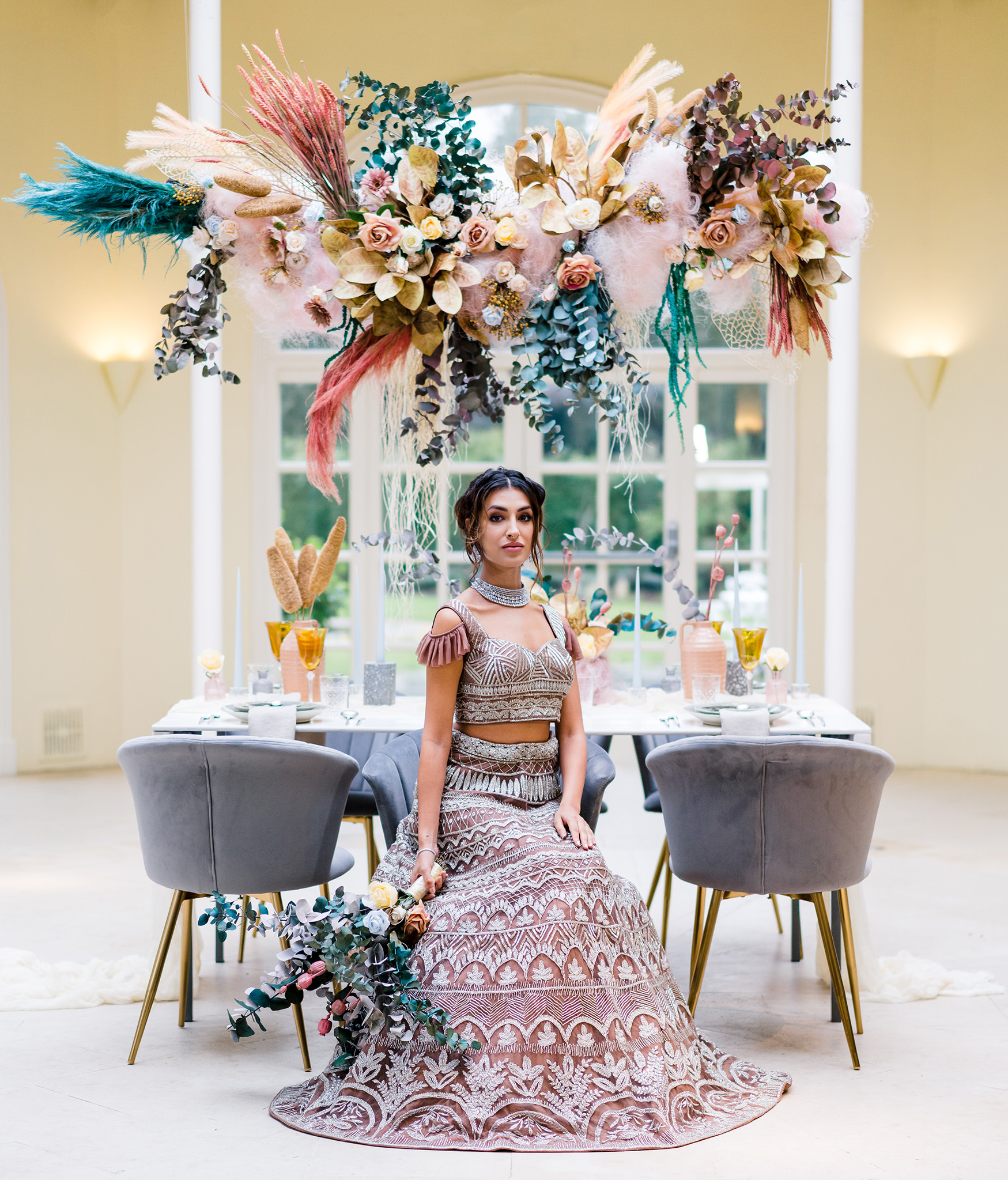 bride in front of wedding decor table